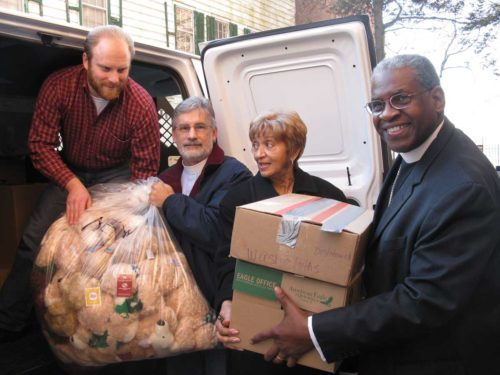 Loading the van with care packages are Bishop Nathan Baxter, Deacon Pete Gdula, Deacon Brenda Taylor and Adam Bentz, volunteer.Photo/Linda Arguedas