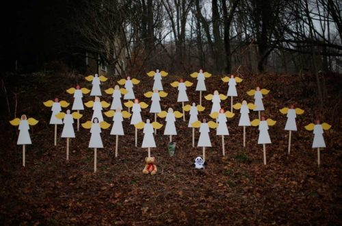 Wooden angel figures are seen placed in a wooded area beside a road near the Sandy Hook Elementary School for the victims of a school shooting in Newtown, Connecticut December 16, 2012. Twelve girls, eight boys and six adult women were killed in the shooting on Friday at the Sandy Hook Elementary School in Newtown. REUTERS/Mike Segar