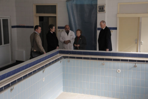 Betty Dagher Majaj, the longtime director of the Princess Basma Center for Disabled Children in East Jerusalem, explains to Presiding Bishop Katharine Jefferts Schori and her staff that the center's hydrotherapy pool remains empty because the center cannot afford to keep it chlorinated and heated. From left, Alex Baumgarten, director of the Episcopal Church's Office of Government Relations, the presiding bishop, Dr. Waddah Malhees, the center's rehabilitation medical director, Majaj, and the Rev. Canon Bob Edmunds, the Episcopal Church's Middle East global partnerships officer. ENS Photo/Lynette Wilson