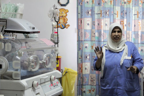 A nurse at St. Luke's Hospital in Nablus gives a tour of the hospital's neonatal unit. An average of 180 babies are born each month at the in the hospital in the West Bank. ENS Photo/Lynette Wilson
