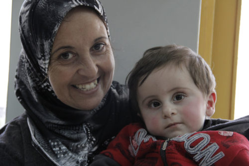A woman and her son receive care at the Princess Basma Center in East Jerusalem. The center operates a through the Women's Empowerment Program to teach women how to care for their disabled children. ENS Photo/Lynette Wilson
