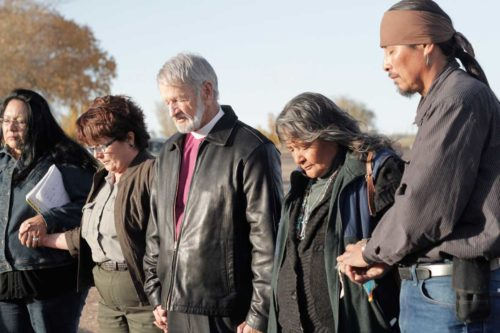 Deacon LaCinda Hardy-Constant, Ranger Grace Roybal, the Rt. Rev. David Bailey, Deacon Catherine Plummer and Arnold Joe, an aspirant, holding hands in prayer during a November visit to the Bosque Redondo Memorial Fort Sumner State Monument in New Mexico. ENS Photo/Lynette Wilson