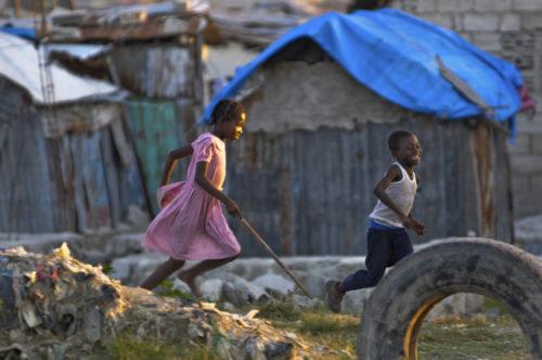 Children play in a slum area in Port-au-Prince