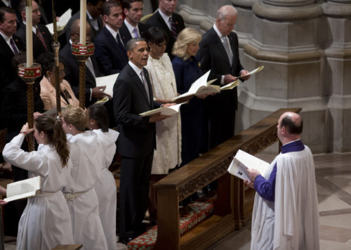 President Barack Obama looks to members of the closing procession of the Presidential Inaugural Prayer Service at the Washington National Cathedral with first lady Michelle Obama, Vice President Joe Biden and his wife Jill Biden, Jan. 22 in Washington. The 106-year-old Episcopal cathedral has long hosted presidential inaugural services, this one following Monday's 57th Presidential Inauguration. AP Photo/Carolyn Kaster