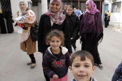 Children smiling for the camera during a visit to Al Ahli Arab Hospital in Gaza City on Jan. 2. ENS Photo/Lynette Wilson