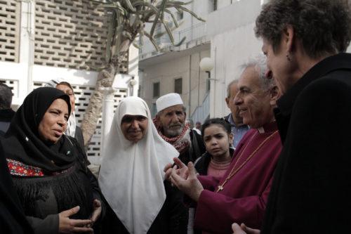 Presiding Bishop Katharine Jefferts Schori and Anglican Bishop in Jerusalem Suheil Dawani listen to a Muslim woman talk about the importance of Al Ahli Arab Hospital on Jan. 2. ENS Photo/Lynette Wilson
