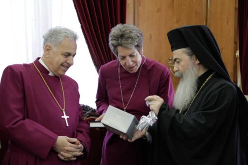 Anglican Bishop in Jerusalem Suheil Dawani, Presiding Bishop Katharine Jefferts Schori and His Beatitude Theophilos III, Greek Patriarch of Jerusalem, exchanging gifts during a meeting in late December at the Greek Orthodox Patriarchate in Jerusalem's Old City. ENS Photo/Lynette Wilson