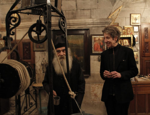 Father Loustinos, the Greek Orthodox priest who is the caretaker and restorer of Jacob's Well in the West Bank city of Nablus, and Presiding Bishop Katharine Jefferts Shori during a visit to the Christian holy site. The Greek Orthodox Patriarchate took control Jacob's Well in 1860. ENS Photo/Lynette Wilson