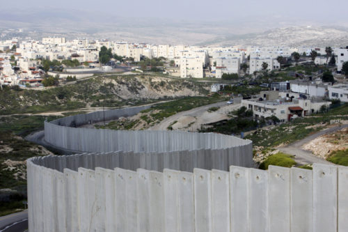 A section of the controversial Israeli barrier is seen between the Shuafat refugee camp (right), in the West Bank near Jerusalem, and Pisgat Zeev (rear), in an area Israel annexed to Jerusalem after capturing it in the 1967 Middle East war. Reuters photo/Ammar Awad