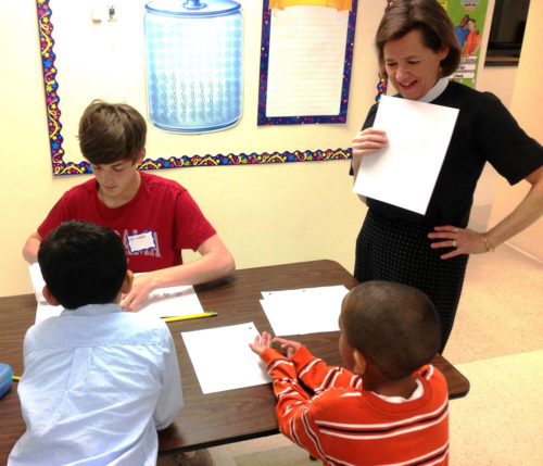 Deacon Lesley-Ann Drake, who founded Path To Shine, tutors students in the Smyrna, Ga., after-school enrichment class sponsored by the Iglesia de San Benedicto, a Spanish-speaking Episcopal congregation. Twenty students are served currently, and there is a waiting list. Photo/Path To Shine