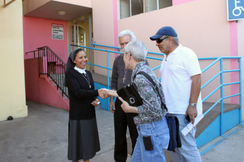 Bishop Suffragan Mary D. Glasspool of the Diocese of Los Angeles, with Fr. Alexei Smith, ecumenical and interreligious officer for the Roman Catholic Archdiocese of Los Angeles, and United Church of Christ minister Carlos Correa Bernier, executive director of the Romero Center, confer with one of the four nuns who operate Casa de Las Pobras (House of the Poor), a ministry to the destitute of Tijuana. A group of some 25 religious leaders from the Los Angeles visited San Diego and Tijuana on Feb. 26 and 27 to learn about the effects of U.S. immigration policy on the poor of Mexico, and begin to determine how they might work for effective, comprehensive immigration reform. Photo: Janet Kawamoto