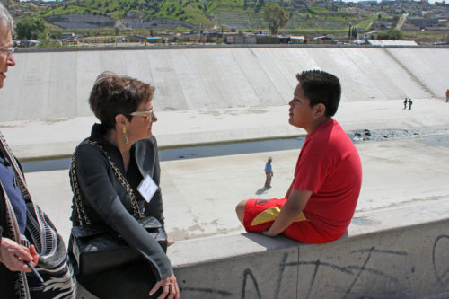 A member of the Los Angeles Council of Religious Leaders talks with Oscar, who grew up in the Los Angeles area but came to Mexico a year and a half ago with his parents, who were deported. The family now lives in Chilpancingo, a shantytown near Tijuana. Photo: Janet Kawamoto