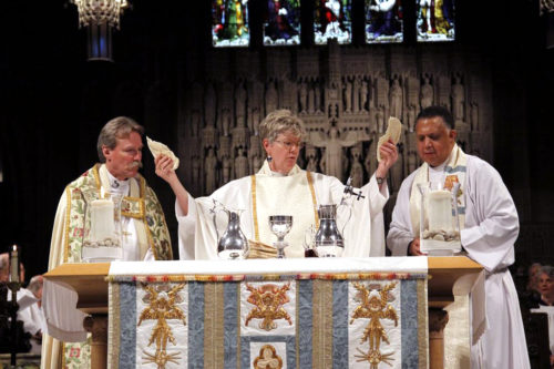 The Very Rev. Tracey Lind, dean of Trinity Episcopal Cathedral in Cleveland, celebrates Eucharist with Diocese of Ohio Bishop Mark Hollingsworth Jr., left, and the Rev. Canon Will Mebane. Photo/San Hubish