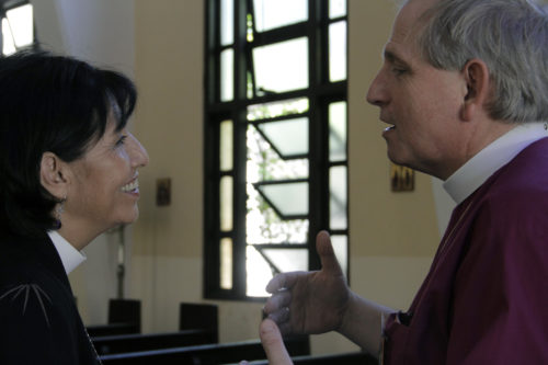 Cuba Bishop Griselda Delgado del Carpio and Diocese of Niagara Bishop Michael Bird talk following a business session. Cuba and Niagara recently renewed their companion diocese relationship. Photo: Lynette Wilson/Episcopal News Service