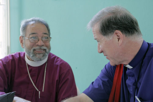 Dominican Republic Bishop Julio César Holguín and Archbishop Fred Hiltz, primate of the Anglican Church of Canada, talk during lunchtime at the Episcopal Church of Cuba's General Synod. Photo: Lynette Wilson/Episcopal News Service