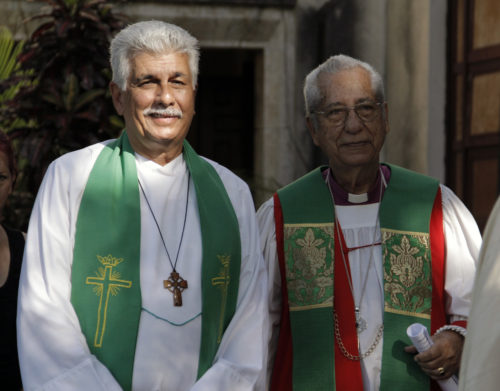 Bishop Miguel Tamayo Zaldívar, former interim bishop of Cuba, and Bishop Ulises Aguero, bishop emeritus of Cuba, during the procession of the closing Eucharist. Photo: Lynette Wilson/Episcopal News Service