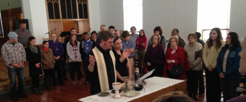The Rev. Jim Hamilton, pastoral missioner for Church on the Square, Canton, celebrates Eucharist on All Saints' Day, Nov. 1, at the opening service of the new church plant in Baltimore. The joint-venture between the Episcopal Diocese of Maryland and the ELCA Delaware-Maryland Synod is the first of its kind on the East Coast. Photo: Dan Webster