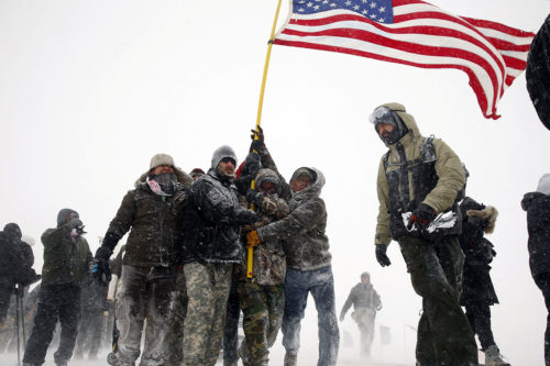 "Veterans join activists in a march to Backwater Bridge just outside of the Oceti Sakowin Camp on Dec. 5 during a snow fall as ""water protectors"" continue to demonstrate against plans to pass the Dakota Access pipeline adjacent to the Standing Rock Indian Reservation, near Cannon Ball, North Dakota. Photo: Lucas Jackson/REUTERS"