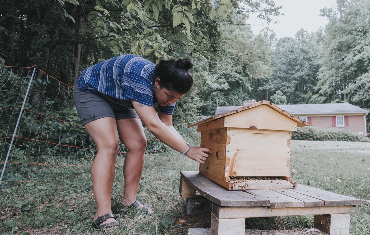 Charis Cofounder Grace Aheron Tends Bees For Honey Farming A Sustainable Practice That S Part Of The Permaculture Values This Intentional Community On