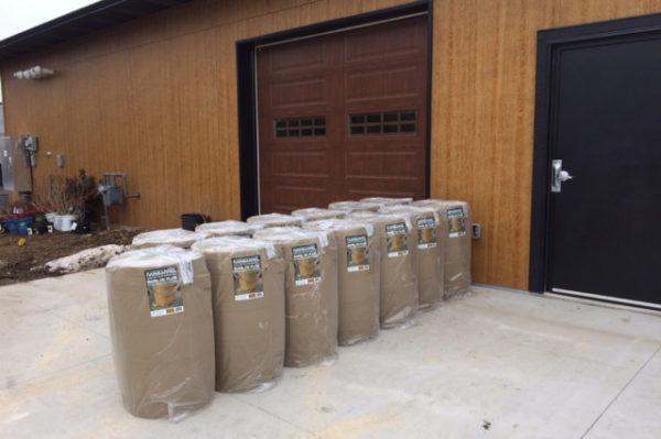 Rain barrels lined up
